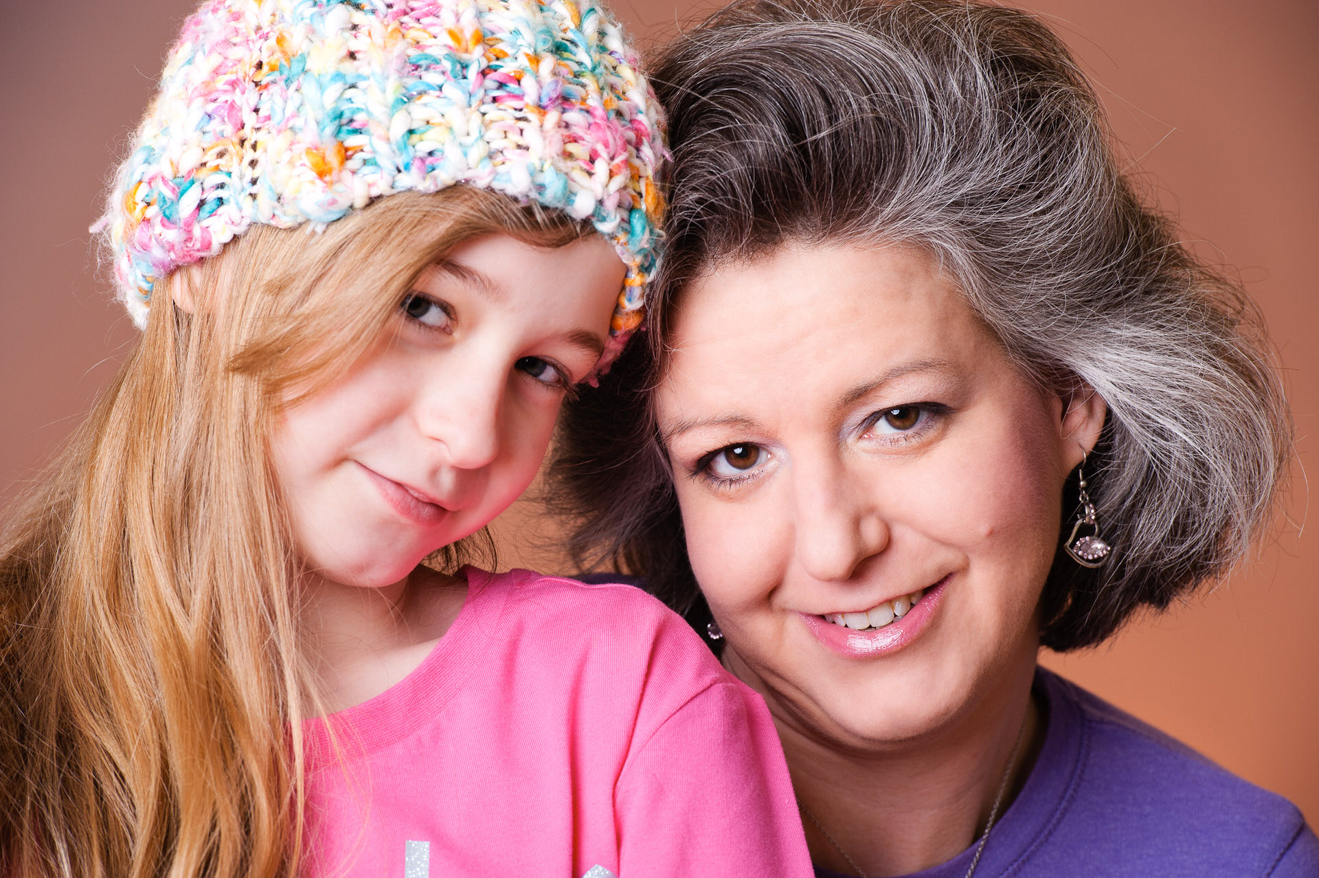Studio faily portrait of mum and daughter