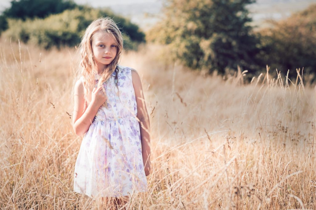 A child location portrait photo in the long grass in late summer.