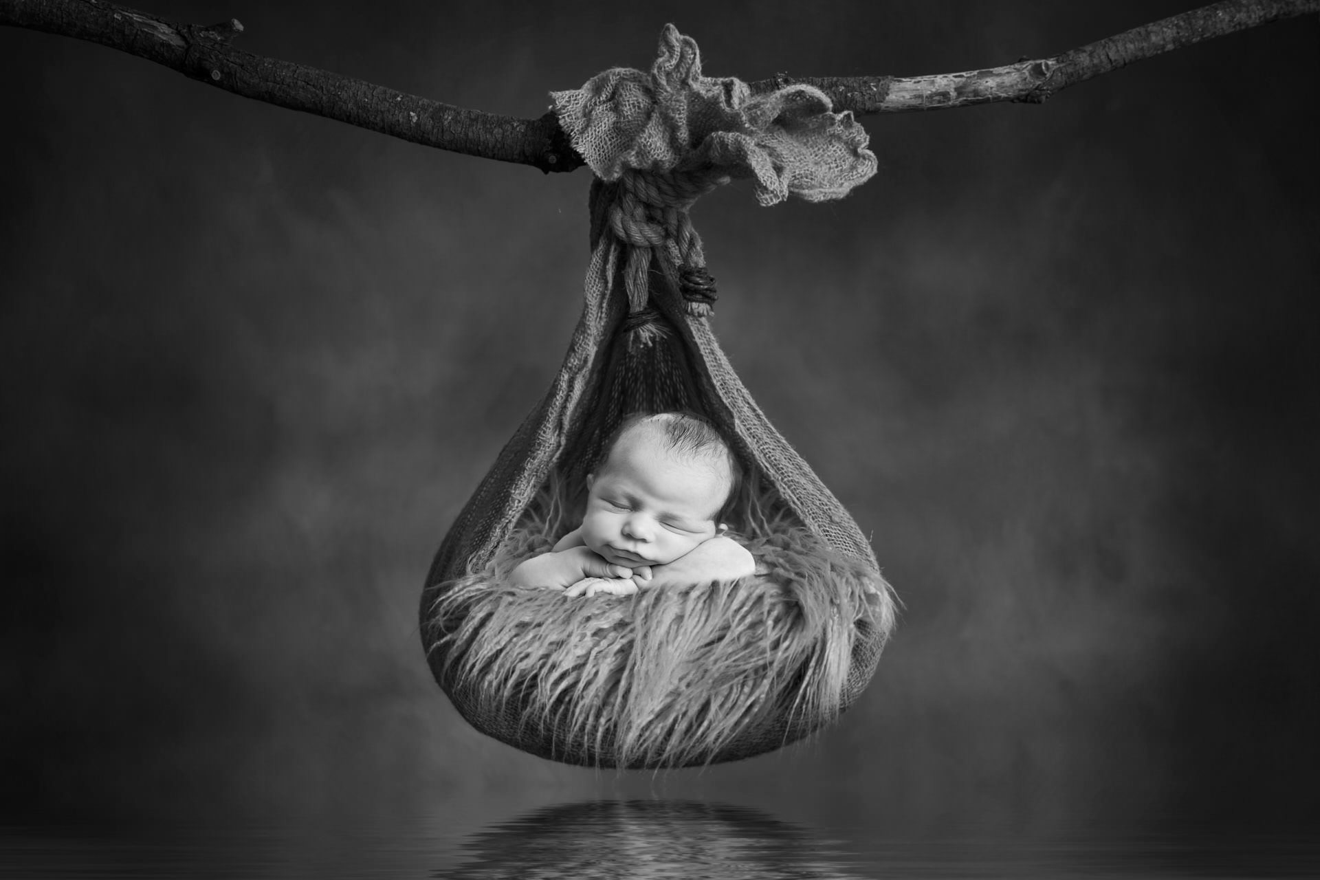 newborn-hanging-in-basket-bw